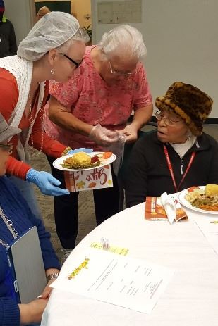 Photo of Newton County Seniors receiving Thanksgiving lunch